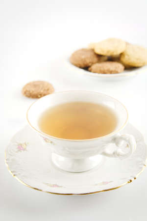 oldstyle: Old-style porcelain cup of tea with cookies vintage style on white background