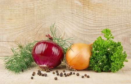 countrified: Onion,red onion,dill,parsley,allspice and black pepper on wooden background