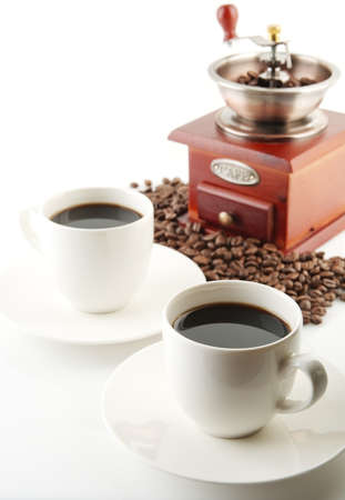 epicure: Coffee cups and saucer and winnower on white