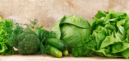 green vegetables: Collection of green vegetables on wooden background