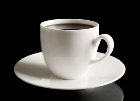 epicure: Coffee cup and saucer on black