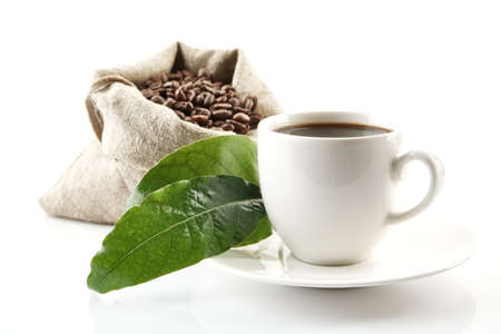 green beans: Bag full of coffee beans with green leaves and coffee cup on white Stock Photo