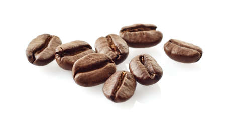 few: Closeup scattered coffee beans on white background