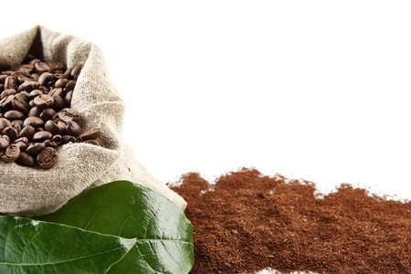 market bottom: Bag full of coffee beans with green leaf coffee powder at the bottom on a white background Stock Photo