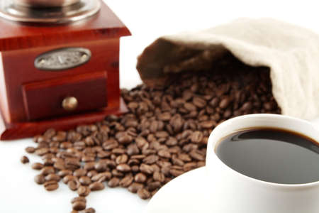 epicure: Coffee cup with winnower and sack of coffee beans on white
