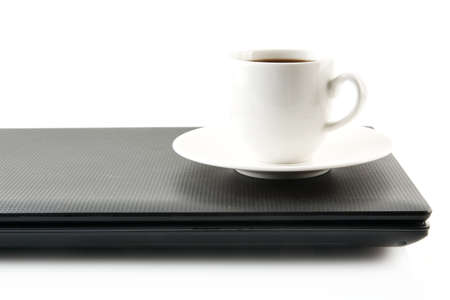 epicure: Cup of black coffee on the laptop at breakfast on white background