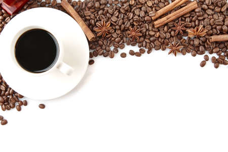 winnower: Closeup scattered coffee cup and beans in line horizontal with anises and cinnamon sticks on white background