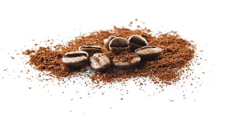 Closeup collected coffee beans with coffee powder on white background