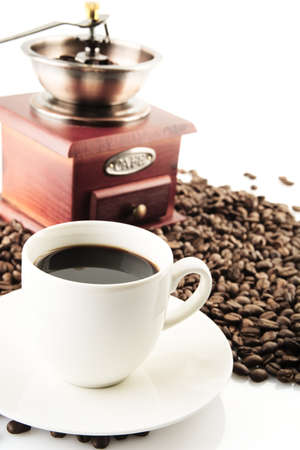 winnower: Coffee cups and saucer and winnower on white