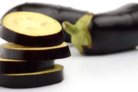 epicure: Closeup view sliced eggplant aubergine fruit on white background