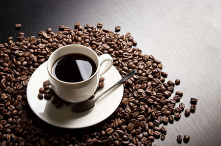 plenty: Macro studio shot of black coffee, plenty of coffee beans view from above with sign yin-yang Stock Photo