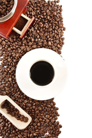 winnower: Coffee cup and saucer and winnower with minced and spilled coffee Stock Photo