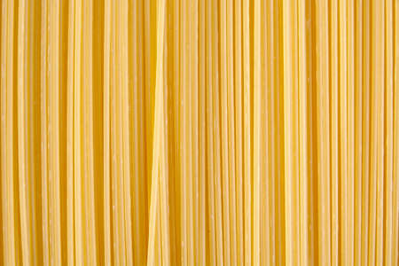 vertically: Background made of raw noodles stacked vertically