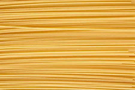 horizontally: Background made of raw noodles stacked horizontally Stock Photo
