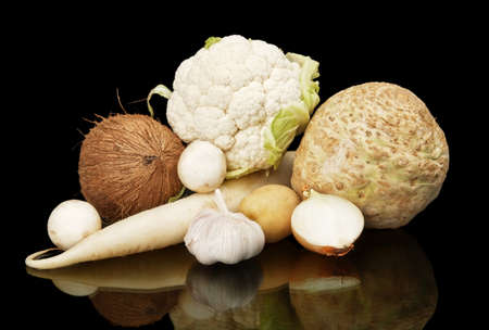 dietetic: White dietetic vegetables-coconut,onion,selery,potato and mushrooms on black background