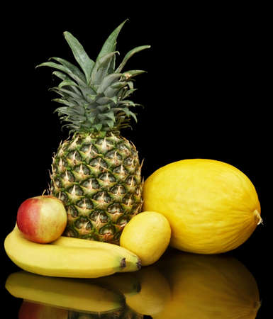 purifying: Group of yellow fruits on black background Stock Photo