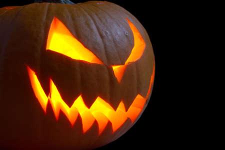 jack o' lantern: Scary face of jack o lantern on black dark backround
