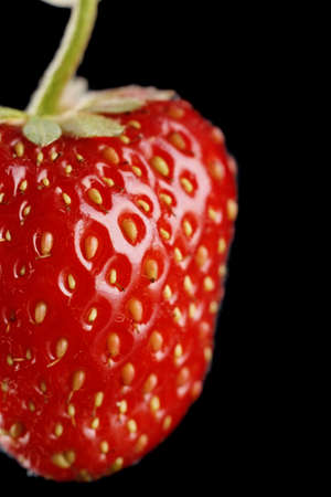 cropped shots: Cropped macro view of single whole strawberry on black background