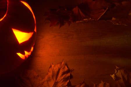 jack o  lantern: Spooky halloween dark red background with jack o lantern Stock Photo