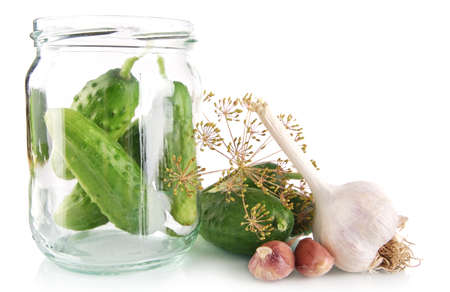 tendrils: Cucumbers in jar preparate for preserving with flower bud,leaves,jar,garlic,dill flowers and tendrils isolated on white background