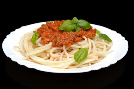 Spaghetti ragu alla bolognese sauce on black background