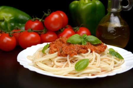 bolognese sauce: Cropped pasta spaghetti bolognese sauce on black Stock Photo