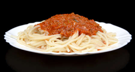 Pasta spaghetti bolognese sauce on black background isolated