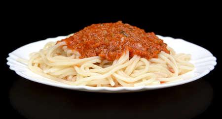 spaghetti sauce: Pasta spaghetti bolognese sauce on black background isolated