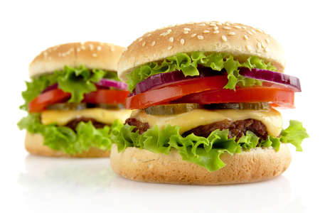 epicure: Big single cheeseburgers isolated on white background