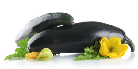 outspreading: Mature two courgettes with flowers on white background Stock Photo