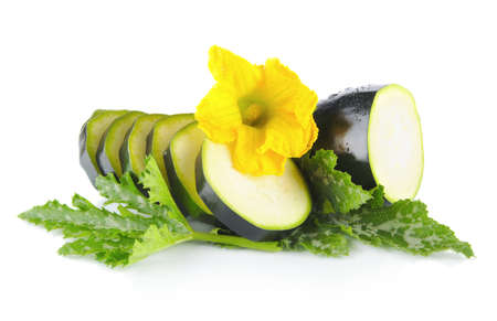 outspreading: Mature courgette cut into slices with flower and courgette leaves on white background