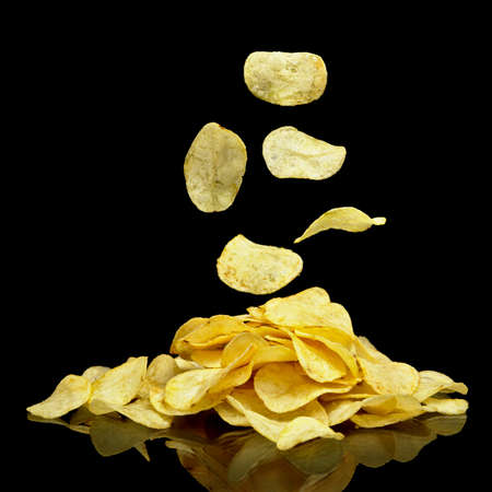 Many potato chips with falling chips Stock Photo