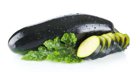 courgettes: Mature courgettes cut into slices and courgette leaves on white background