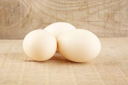 white eggs: Easter white eggs on wooden background made from plank,desk,board