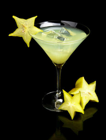 margarita drink: Cosmopolitan margarita drink with carambola fruit with ice cubes on black background in the club or party Stock Photo