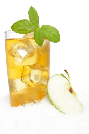 Apple juice,ice cubes and whole apple and mint herb on white background on snow