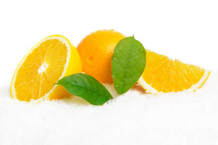 Orange fruits with ice cubes and orange fruit with citrus leaves on ice on white background Stock Photo
