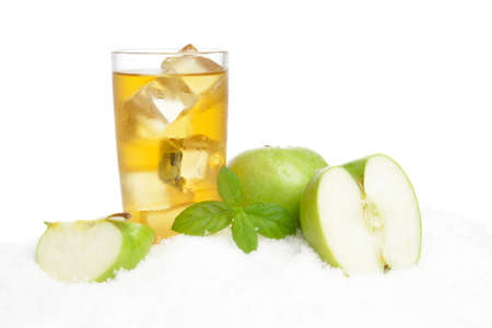 Apple juice,ice cubes and whole apple and mint herb on white background on ice Stock Photo