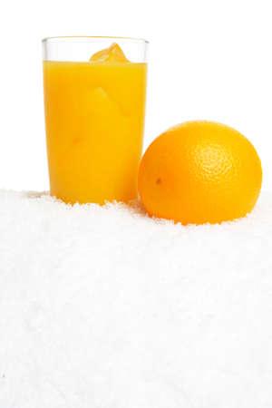 Orange juice with ice cubes on ice on white background