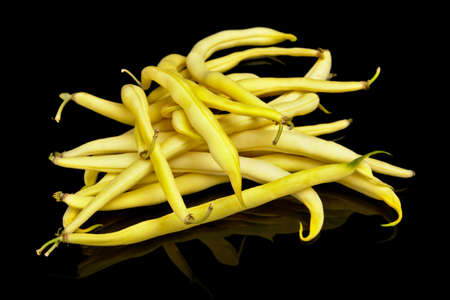 Stack of yellow beans on black background,healthy food