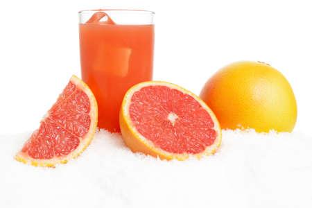 Grapefruit juice,ice cubes with grapefruits on ice on white background
