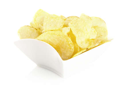 Salted potato chips in the bowl on white background