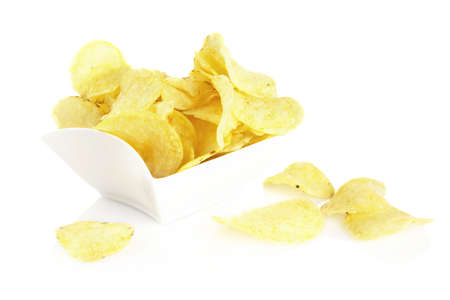 Salted potato crisps in the bowl on white