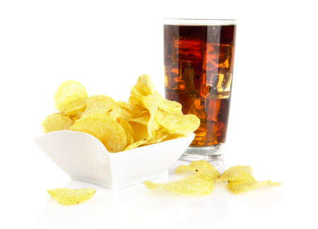briny: Salted potato crisps in the bowl with cola on white Stock Photo