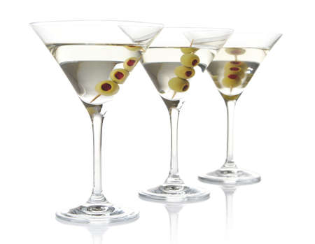 Three glasses of classic dry martini with olives isolated on white background