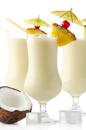 Cropped view of Pina colada cocktails with straw isolated on white background 스톡 콘텐츠