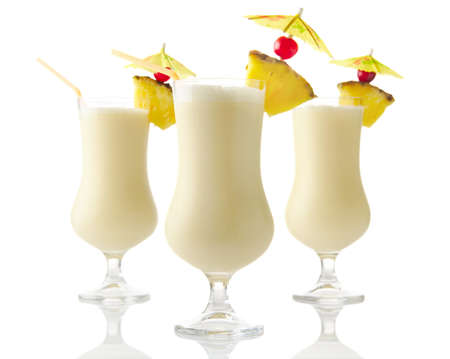 Three Pina colada coconut cocktails isolated on white background