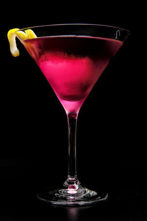 Pink cosmopolitan cocktail isolated on black background