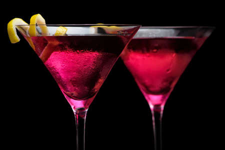 Closeup cosmopolitan drinks isolated on black background Фото со стока