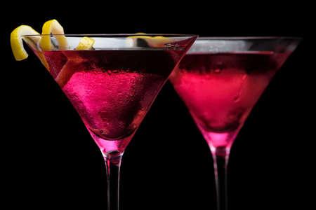 Closeup cosmopolitan drinks isolated on black background 版權商用圖片
